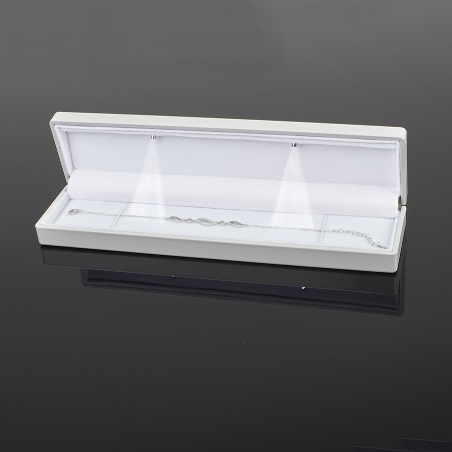 Cutie din plastic cu LED pt BRATARA pe alb